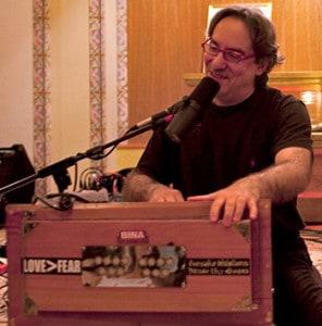 Kirtan-Rabbi-happy-at-harmonium-web