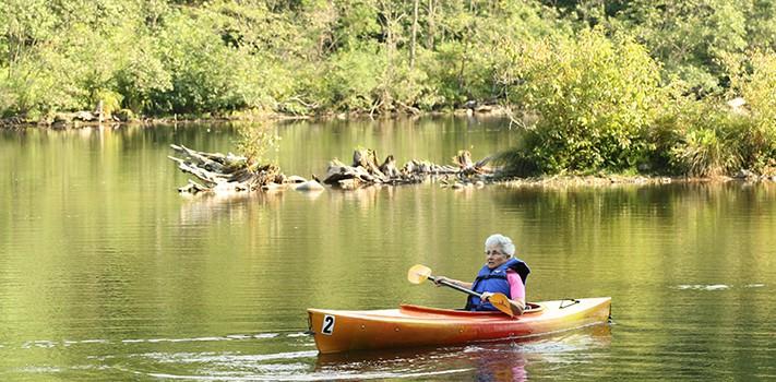 banner - older woman kayaking